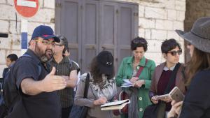 Yehuda Shaul (left) during a Breaking the Silence tour in Hebron (photo: Oren Ziv)