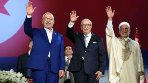 Tunisian President Beji Caid Essebsi (centre), Ennahda leader Rachid al-Ghannouchi (left) and Vice-President Abdelfattah Mourou (right) at the Ennahda party conference (photo: FETHI BELAID/AFP/Getty Images)
