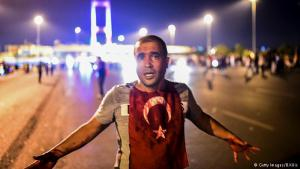 Bloodshed at the Bosphorus: a blood covered resident of Istanbul stands near the Bosphorus Bridge. There were clashes between civilians and the army after the military had blocked the bridge on Friday night. Government sources say that more than 260 people were killed in fighting during the coup attempt