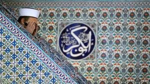 Imam in a mosque (photo: Nikolay Doychinov/AFP/Getty Images)