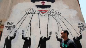 The Egyptian military pulls the strings of power – graffiti on a wall close to Tahrir Square in Cairo (photo. Reuters)