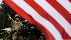 A US soldier stands on his Stryker vehicle as a US military convoy passes into the Czech Republic at Harrachov
