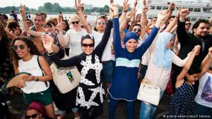 "Against the burkini ban: it's not a real beach and not France; nonetheless, it was a symbolic gesture against the now-overturned burkini ban on some French beaches. ""Women and men should decide for themselves what they want to wear,"" said a woman wearing a bikini at the event"