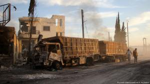 Bombed out aid convoy on the road to Aleppo