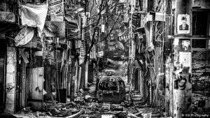 "Total destruction: photographer Yusuke Suzuki travelled over the Turkish border into Aleppo, in Syria. This picture in his series ""City of Chaos"" shows a once-lively shopping street. ""When I arrived in Aleppo, I realised that there wasn't any water, gas, electricity, nor medicine, schools, jobs or baby milk here, he said"