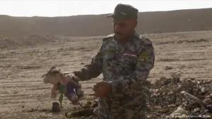 "Iraqi army discovers a mass grave: while Iraqi troops advanced further into territory held by the so called ""Islamic State"" in their campaign to recapture Mosul, they found a mass grave which holds about 100 bodies, many of them decapitated. AP footage shows bones and decomposed bodies dug out of the ground by a bulldozer. This Iraqi federal police officer holds a stuffed animal he found on the site"