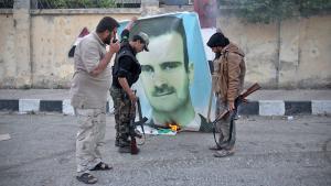Nusra Front Islamists burn an Assad poster in Idlib (photo: Getty Images/AFP/O. Haj Kadour)