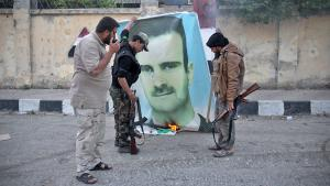 Nusra Front Islamists burn an Assad poster in Idlib (photo: Getty Images/AFP/O. Haj Kadour)