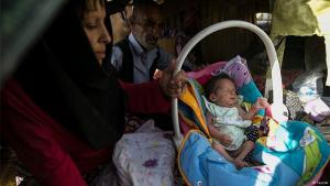 A drug addict sells her baby on the streets of Tehran