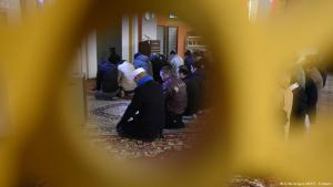 Worshippers attend Friday prayers at the mosque of the Lahore Ahmadiyya movement in Berlin, 2014
