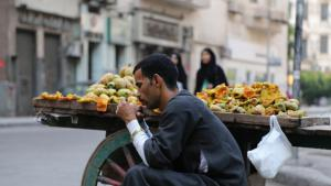 Young street vendor waiting in vain for customers in Cairo