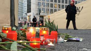City in shock: on Tuesday morning, just hours after a truck ploughed into a Christmas market in the heart of the city, candles and roses had been laid near the entrance of a nearby station. Security forces are patrolling trains and train stations, police are on high alert in Berlin as flags fly at half-mast. Streets in the area of the incident remain closed off, and buses have been re-routed