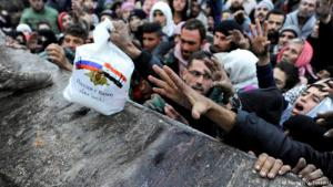"""""""Russia is with you!"""": Russian food aid handout in Aleppo"""