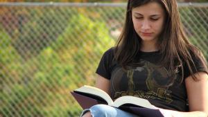 Stock image of a teenage girl reading (source: freestockphotos.biz)