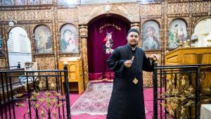 Father Filtawos stands in front of the altar of his church in Ezbeth Raflah (photo: Flemming Weiss-Andersen)