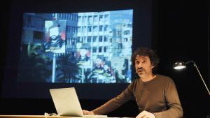 "Mroué during his lecture performance ""The Pixelated Revolution"" (source: kampnagel.de)"
