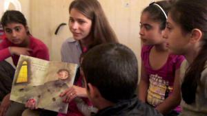 Syrian picture-book author, Nadine Kaadan, reads to a group of children (source: private)