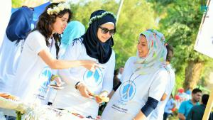Volunteers operate a stall at Baghdad City of Peace Carnival held on World Peace Day (source: iqpeace.com)