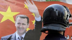 Flag bearing the likeness of Syrian dictator Assad outside the Syrian Embassy in Beirut (photo: picture-alliance/dpa)