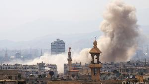 A bomb explodes in a suburb of Damascus (photo: AFP/Getty Images)