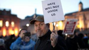 Man holding a placard at the Trafalgar Square vigil for victims of Wednesday's attack (photo: Getty Images/J. Taylor)
