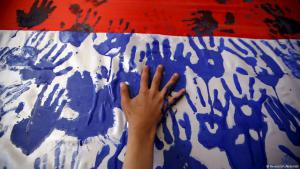 Handprints as a symbol of protest against Saudi airstrikes in Yemen (photo: Reuters)