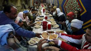 "Free meals are distributed to the needy in many Muslim countries during Ramadan. The giving of alms forms one of the ""five pillars of Islam"" – alongside the declaration of faith, daily prayers, the pilgrimage to Mecca and fasting. Followers of the faith refrain from eating and drinking from dawn to dusk. When evening comes, many meet in mosques, on public squares or in marquees such as in this picture from Cairo, to celebrate the breaking of the fast, known as ""Iftar"""