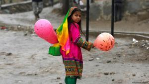 Afghan girl toting balloons during Nowruz celebrations in Kabul (photo: Reuters/Omar Sobhani)