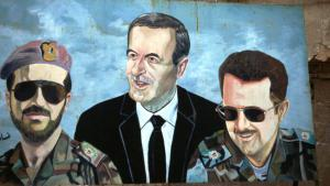Mural in Damascus showing former Syrian dictator Hafiz al-Assad with his sons (photo: Reuters)