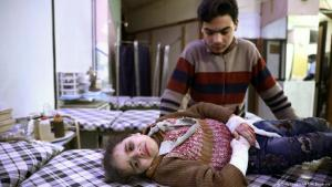 An injured girl waiting for medical treatment in the Syrian town of Duma (photo: AFP/Getty Images)