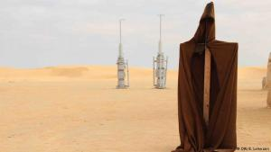"""Look like a real Jedi: they look like two wooden rockets, but fans will recognise the moisture vaporators in use on planet Tatooine: they were left behind to show that this was once the location of the spaceport of Mos Espa, a """"Star Wars"""" settlement. Visitors can take pictures of themselves wearing an """"original Jedi cloak"""" – at least that's what the souvenir sellers claim they are"""