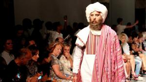 """'Rise from the Ashes': in the Western world, traditional Afghan clothing is often associated with war – images of Islamist fighters donning turbans, drooping cloaks. But the attire is basically part of the rich Afghan culture. In his latest Amsterdam show, """"Rise from the Ashes"""", Afghan-Dutch designer Nawed Elias attempted to alter the Western perception"""