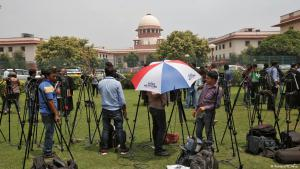 Reporters wait outside the Supreme Court in New Delhi for the verdict on triple talaq (photo: Reuters)