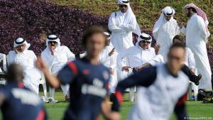Owner of Saint German football club, Nasser al-Khelaifi and Crown Prince Sheikh Tamim bin Hamad al-Thani attend a training session in Doha, 2012 (photo: Franck Fife/AFP/Getty Images)