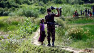 Bangladesh border guard at Cox's Bazar prevents Rohingya girl from crossing border (photo: Reuters/M. Ponir Hossain)