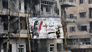 Poster of the Syrian president in East Aleppo (photo: George Ourfalian/AFP)