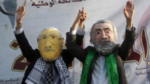 Palestinians don masks of Palestinian Authority President Mahmoud Abbas and Hamas leader Ismail Haniya's faces (photo: AP)