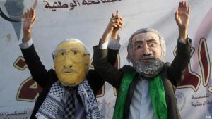 Palestinians don masks of Palestinian Authority President Mahmoud Abbas and Hamas leader Ismail Haniya's faces (photo: AP)
