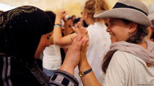 A Palestinian and a Jewish woman join hands during the recent Women Wage Peace march staged across Israel and the Palestinian territories (photo: Reuters/R. Zvulun)