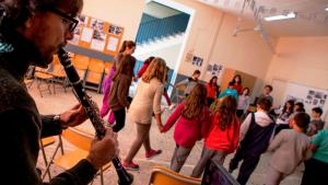 Oboist accompanies dancing children and teenagers in a school on the Greek island of Chios (photo: Stamatis Menis)