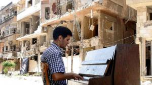 Aeham Ahmad playing his piano among the rubble, Syria (source: YouTube)