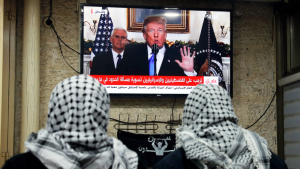 Palestinians watch Trump's announcement that he now recognises Jerusalem as the capital of Israel (photo: Getty Images)