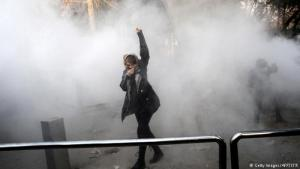A protester raises a fist in defiance in a cloud of tear gas (photo: Getty Images/AFP/STR)