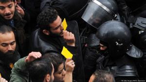Tunisian protesters confront security forces blocking access to the governorate's office in Tunis, during a demonstration over price hikes and austerity measures, 12 January 2018 (photo: Getty Images/AFP/S. Hamdaoui)