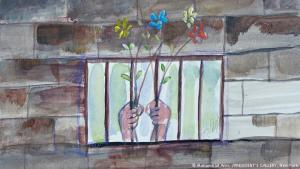 'Hands Holding Flowers through Bars' (2016): Muhammad al-Ansi was born in Yemen and was held at the Guantanamo Bay detention camp for a total of 15 years under extrajudicial detention practices. He alleges that he was tortured during his incarceration, saying that painting helped him cope with the conditions at Guantanamo. Creating landscapes and flowers helped him escape the reality of everyday life at the notorious prison