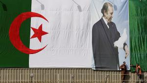 Algerian flag bearing the likeness of President Bouteflika in Algiers (photo: Reuters)
