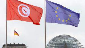 Tunisian and European Union flags fly over the dome of the German Parliament (photo: Soeren Stache/dpa)
