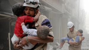 White Helmet volunteers rescue children from the destruction of Aleppo (photo: Reuters)