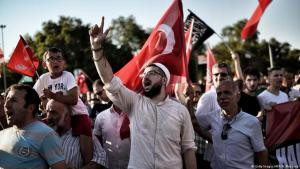 Religious nationalist Erdogan supporters during a demonstration in Istanbul (photo: ARIS MESSINIS/AFP/Getty Images)