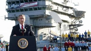 U.S. President George W. Bush addresses the nation aboard the nuclear aircraft carrier USS Abraham Lincoln and declares major fighting over in Iraq on 1 May 2003, as it sails for Naval Air Station North Island, San Diego, California (photo: AFP Photo/Stephen Jaffe)